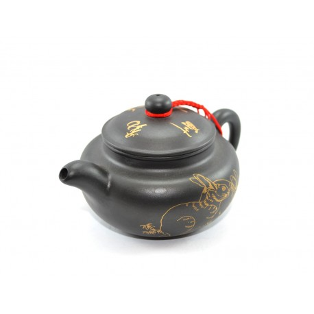 Black clay teapot with a rabbit